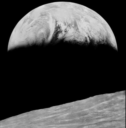 The Earth Rising From The Moon's Surface