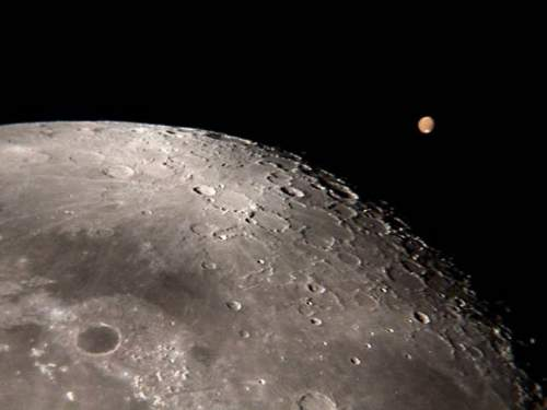 The Planet Mars Above The Moon