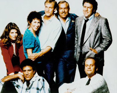 Rebecca Howe (Kirstie Alley), Sam Malone (Ted Danson), Carla tortelli (Rhea Perlman), (Woody Harrelson), Cliff Clavin (John Ratzenberger), Norm Peterson (George Wendt) and Dr. Frasier Crane (Kelsey Grammer) In Cheers
