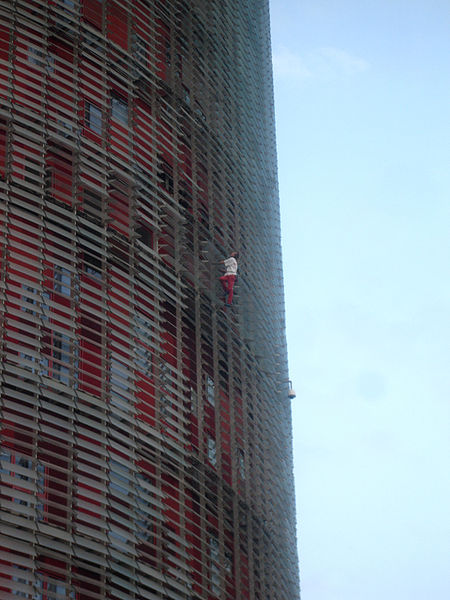 Alain Robert Climbing Agbar Tower In Barcelona