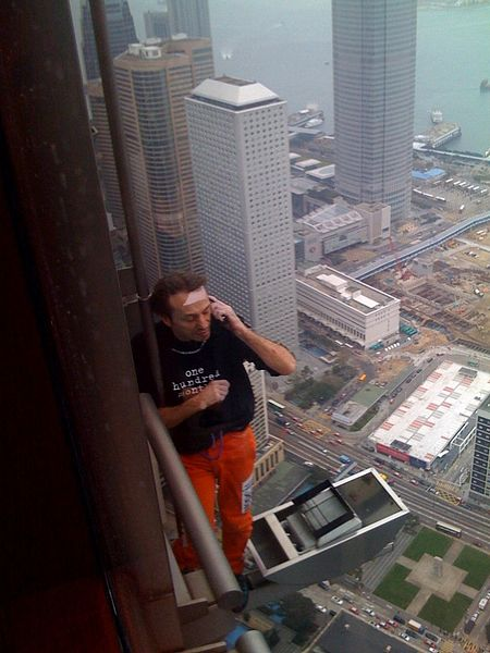 Alain Robert Quotes Resting While Climbing A Building In Hong Kong Photo Coutesy Of Shiny Things