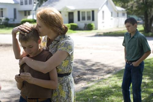 R.L (Laramie Eppler), Mrs. O'Brien (Jessica Chastain, and Young Jack (Hunter McCracken) In Tree Of Life