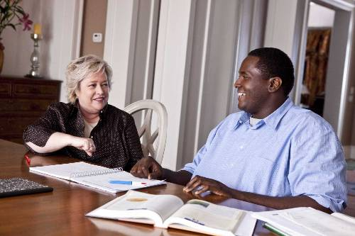 Miss Sue (Kathy Bates) And Michael Oher (Quinton Aaron) In The Blind Side