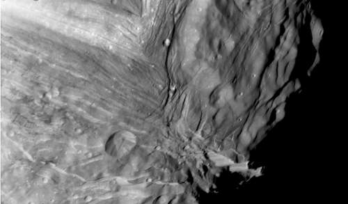 Close Up Of Uranus's Moon Miranda's Rugged Cratered Terrain