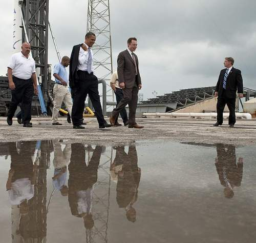 Elon Musk With Barack Obama During A Tour Of The Falcon 9 Launch Site Photo By Bill Ingalls