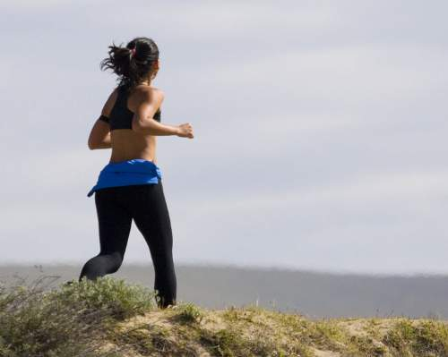 Woman Jogging Photo By Mike Baird