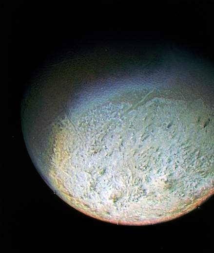 Showing The Surface Of Neptune's Moon Triton